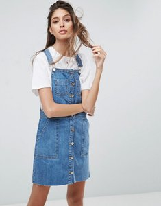 Read more about Asos denim dungaree button through mini dress in midwash blue - blue