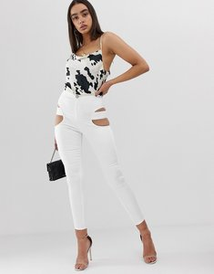 Read more about Asos design rivington high waisted jegging with cut out thigh detail in optic white