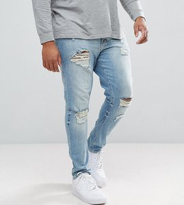 Read more about Asos plus skinny jeans in light wash with heavy rips - light wash vintage