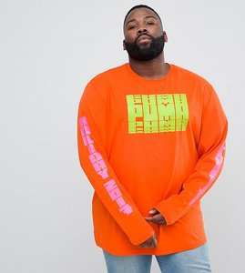 Read more about Puma plus graphic long sleeve t-shirt with arm print in orange exclusive to asos - orange