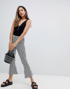Read more about Asos design flare cropped leggings in dogtooth check