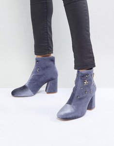 Read more about Stadivarius block heel embellished sock boot - blue