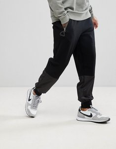 Read more about Asos drop crotch joggers with zip pockets and woven panels - black