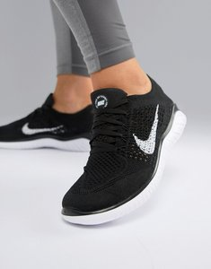 Read more about Nike running free run flyknit trainers in black - black