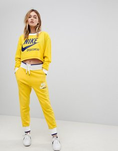 Read more about Nike exclusive to asos archive sweatpants in yellow - vivid sulfur white
