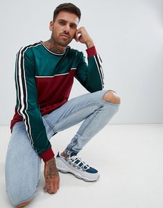 Read more about Asos design relaxed longline long sleeve t-shirt with contrast yoke in woven fabric and taping in bu