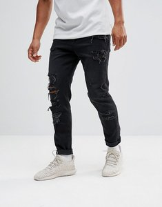 Read more about Asos design tapered jeans in 12 5oz in washed black with heavy rips - washed black