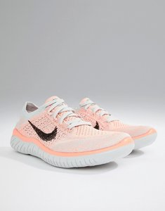 Read more about Nike running free run flyknit trainers in grey and pink - grey