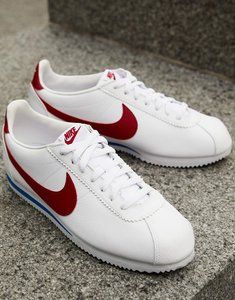 Read more about Nike cortez leather trainers in white with red swoosh