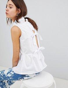 Read more about Glamorous sleeveless shirt with pephem - white