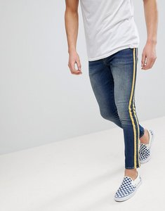 Read more about Asos super skinny jeans in mid wash with yellow side stripes - mid wash blue