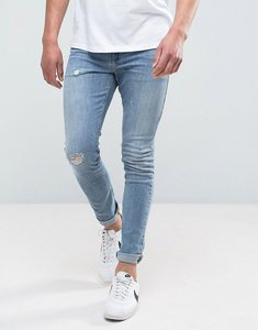 Read more about Asos design super skinny jeans in mid wash blue with abrasions - mid wash blue