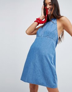 Read more about Asos design denim halter neck mini dress in midwash blue - blue