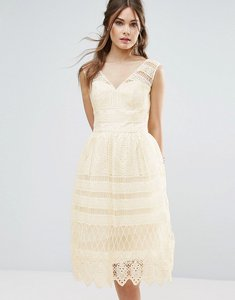 Read more about Chi chi london midi dress in panelled lace - cream