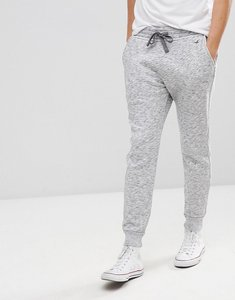 Read more about Hollister icon logo fleece cuffed jogger in white black printed texture - white black printed