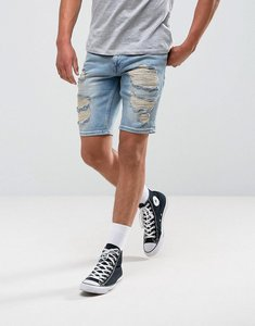 Read more about Asos denim shorts in slim mid wash blue with heavy rip and repair - mid wash blue