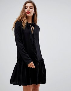 Read more about Asos design neck tie mini smock dress with long sleeves and button front