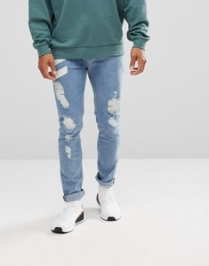 Read more about Asos skinny jeans in mid wash with chevron print and rips - mid wash blue