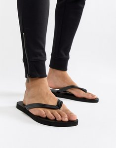 Read more about United colors of benetton flip flops in black - 700