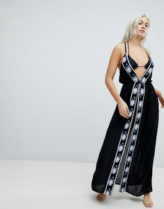 Read more about Liquorish split front maxi beach dress with embroidery - black white