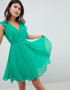 Read more about Asos design ruffle mini dress with open back - green