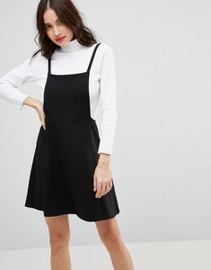 Read more about Asos mini pinafore dress with strappy back - black