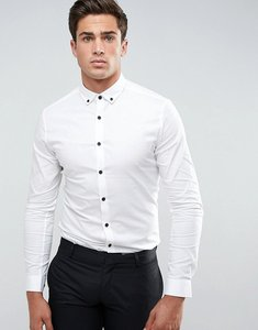 Read more about Asos skinny shirt in white with contrast buttons and button down collar - white