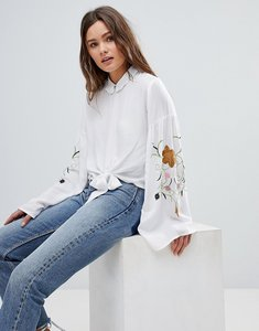 Read more about Glamorous high neck blouse with embroidered sleeves - white