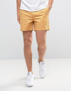 Read more about Asos slim shorter chino shorts in mustard yellow - honey mustard