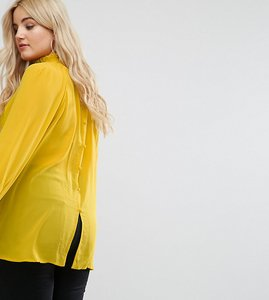 Read more about Alice you high neck top with button back detail - yellow