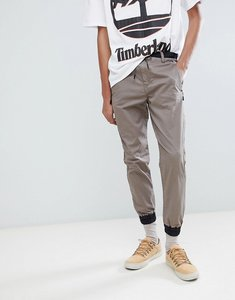Read more about Timberland hybrid chino cuffed joggers in light khaki - bungee cord