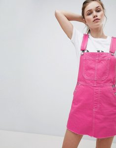 Read more about Bershka dungaree dress in pink - pink