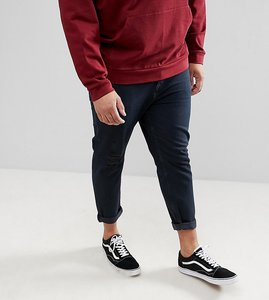 Read more about Asos design plus tapered jeans in overdyed wash with rips - dark wash blue