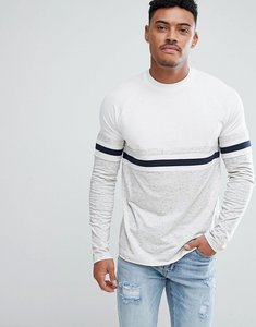Read more about Asos design relaxed long sleeve raglan t-shirt with colour block in interest nepp fabric - off white