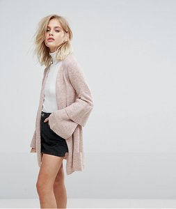 Read more about Only ruffle hem sleeve cardigan - pink