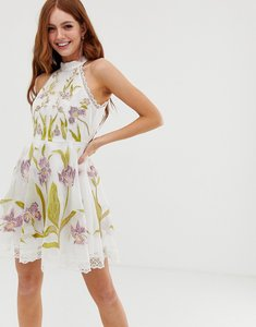 Read more about Asos design high neck mini dress with cut outs and embroidery and lace