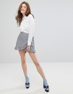 Read more about Willow and paige wrap front mini skirt with ruffle trim in gingham - blue