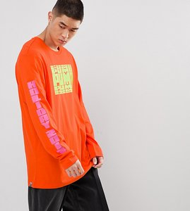 Read more about Puma graphic long sleeve t-shirt with arm print in orange exclusive to asos - orange
