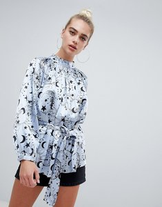 Read more about Asos design high neck satin blouse in moon and star print - multi