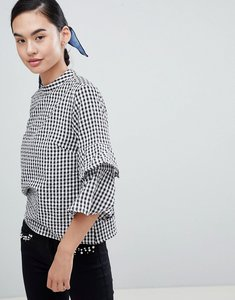 Read more about Only peptia gingham ruffle sleeve top - black white