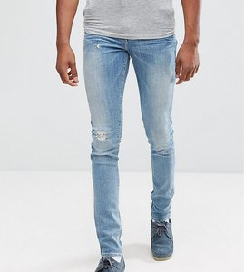 Read more about Asos tall super skinny jeans with abrasions in mid wash blue - mid wash blue