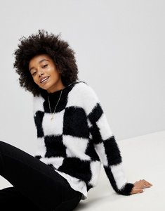 Read more about Asos jumper in fluffy check board pattern - black