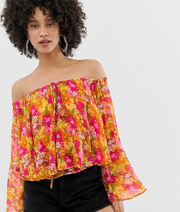 Read more about Sacred hawk tie neck smock top in floral