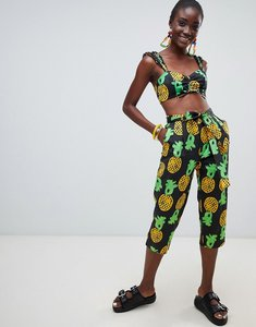 Read more about Asos made in kenya x julie adenuga relaxed trousers in pineapple print - pineapple print