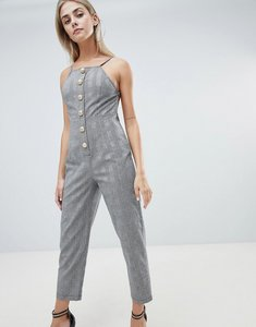 Read more about Prettylittlething button front tailored jumpsuit in check - grey