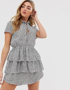 Read more about Boohoo exclusive tiered ruffle mini dress with keyhole tie detail in polka dot
