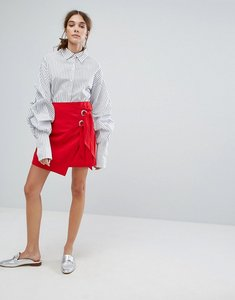 Read more about Neon rose mini skirt with wrap front and eyelet ties - red