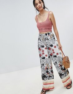 Read more about Parisian wide leg floral trousers with border print - white