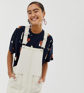 Read more about Monki dungaree dress in cream with contrast stitching