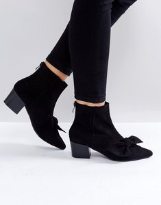 Read more about Raid baretti black bow mid heeled ankle boots - black suede